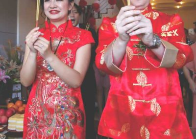 Corey wore a traditional Chinese-style silk jacket, aTangzhuang, while Bella wore a red silk dress called a Qipao