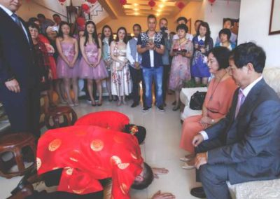 The couple formally bowed to her parents and immediate family before serving them a ceremonial ginger tea.