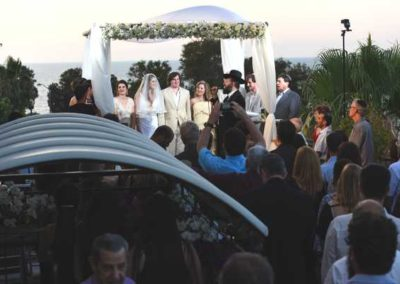 The couple said their vows as the sun set over the Mediterranean Sea.