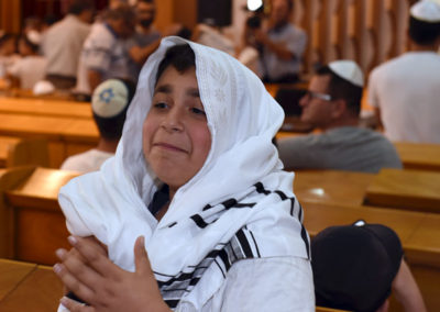 A young man is overjoyed to celebrate his Jewish faith.