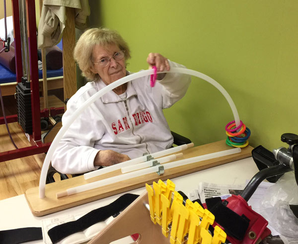 Shirley uses the new Shoulder Arc donated by a generous couple.