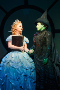 Amanda-Jane-Cooper-as-Glinda-and-Jessica-Vosk-as-Elphaba-C.-Photo-by-Joan-Marcus